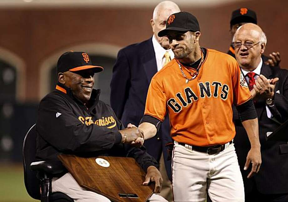 The Willie Mac Award was awarded to Giants outfielder Andres Torres by Hall of famer Willie McCovey in front of a sell out crowd awaiting the start of the Giants Padres game at AT&T Park in San Francisco Friday October 1, 2010 Photo: Lance Iversen, The Chronicle