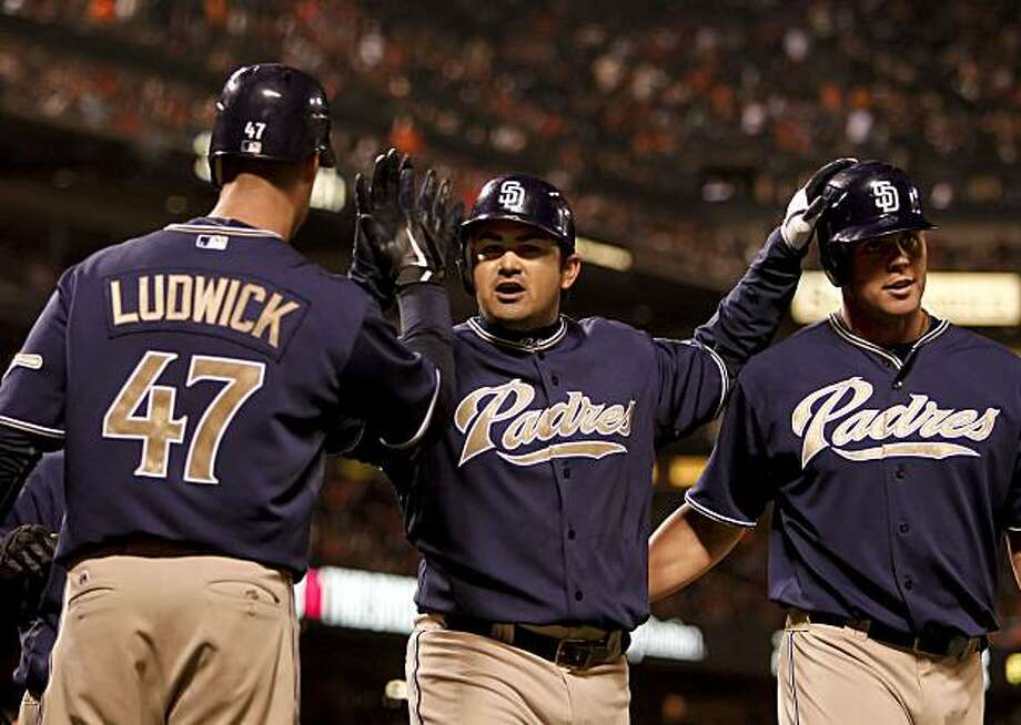 The Padres' Adrian Gonzalez (center) celebrates his three-run homer in the third inning against the Giants to make it 4-0 San Diego on Friday. Photo: Michael Macor, The Chronicle