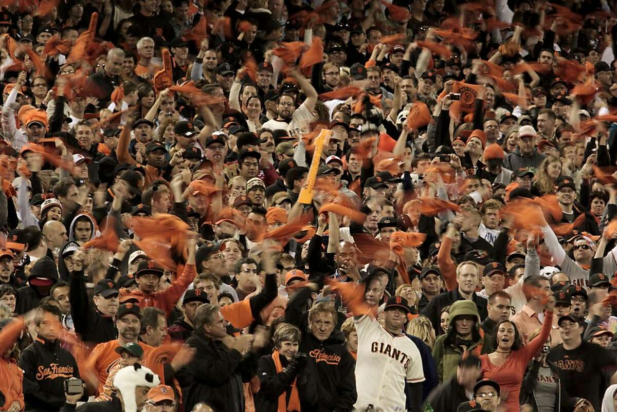 Giants fans try to mount a late inning rally for their team against the San Diego Padres in San Francisco on Friday.
