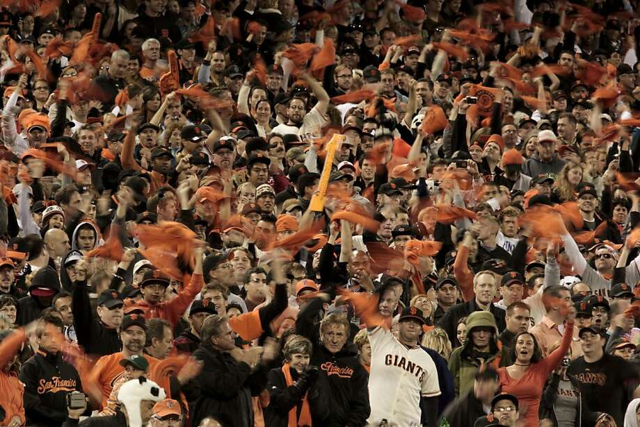 Giants fans try to mount a late inning rally for their team against the San Diego Padres in San Francisco on Friday. Photo: Michael Macor, The Chronicle