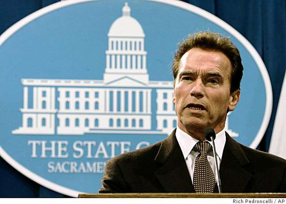 Gov. Arnold Schwarzenegger calls on state lawmakers to settle their differences and reach a solution to the growing state budget deficit during a Capitol news conference in Sacramento, Calif., Wednesday, Dec. 10, 2008.(AP Photo/Rich Pedroncelli) Photo: Rich Pedroncelli, AP