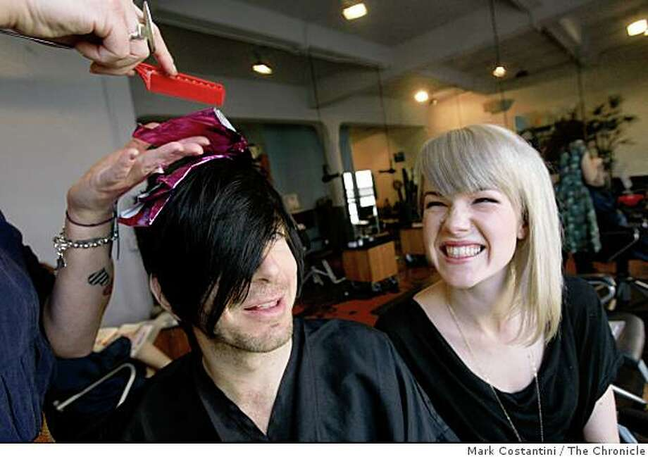 Party promoters Jeffrey Paradise (left) and Ava Berlin sit as Paradise gets his hair worked on at Cowboys and Angels hair salon in San Francisco, Calif., on Friday, January 30, 2009. Photo: Mark Costantini, The Chronicle