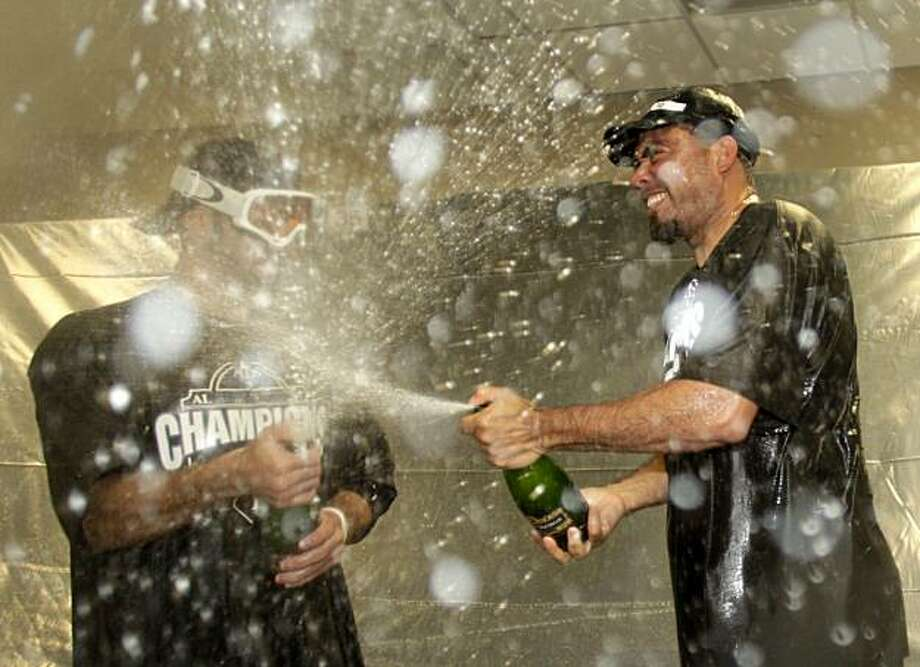 Tampa Bay Rays' Joaquin Benoit, right, and Sean Rodriguez celebrate in the clubhouse after after winning the National League East championship following a 3-2 win over the  Kansas City Royals in a baseball game Sunday, Oct. 3, 2010 in Kansas City, Mo. Photo: Charlie Riedel, AP