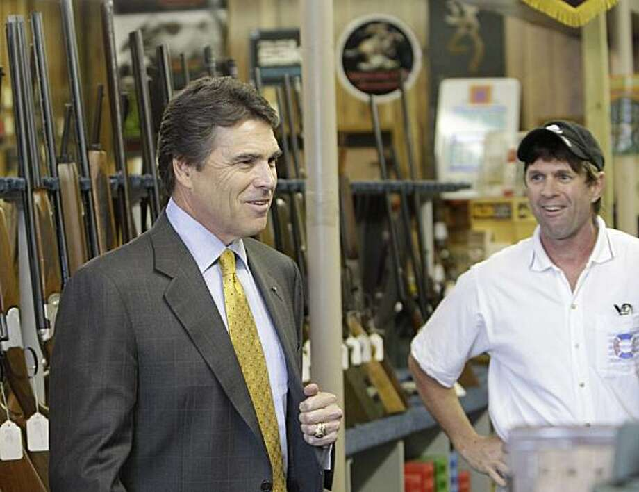Texas Gov. Rick Perry arrives at a gun shop for a campaign event in Dallas, Thursday, Sept. 16, 2010.  Perry, touting his pro-gun credentials in his re-election campaign, was on hand to pick up the endorsement of the National Rifle Association. Photo: LM Otero, AP