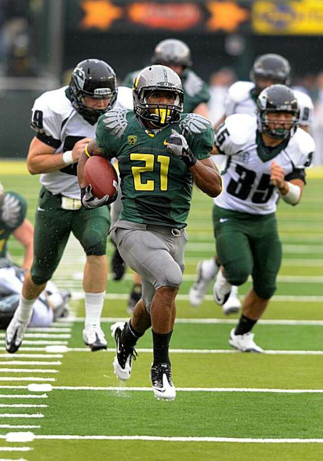 EUGENE, OR - SEPTEMBER 18: Running back LaMichael James #21of the Oregon Ducks heads to the end zone for a touchdown as defensive end Jack Forbes #99 and linebacker Kevin Takeno #35 of the Portland State Vikings give chase in the second quarter of the game at Autzen Stadium on September 18, 2010 in Eugene, Oregon. Photo: Steve Dykes, Getty Images