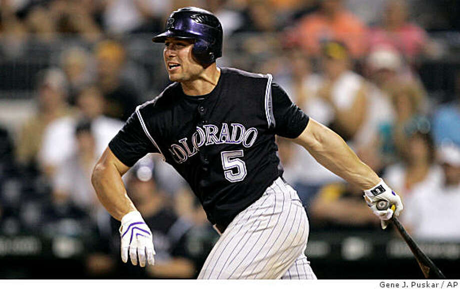 ** FILE ** This July 29, 2008 file photo shows Colorado Rockies' Matt Holliday following through on a swing during a baseball game against the Pittsburgh Pirates in Pittsburgh. The Oakland Athletics have completed their trade for star outfielder Matt Holliday from the Colorado Rockies, acquiring the big bat they wanted for the middle of their lineup. (AP Photo/Gene J. Puskar, File) Photo: Gene J. Puskar, AP