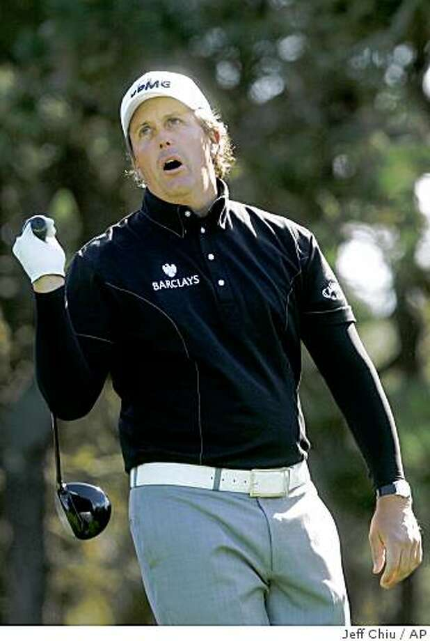 Phil Mickelson reacts to his provisional shot on the 12th tee at Poppy Hills golf course during the second round of the AT&T Pebble Beach National Pro-Am golf tournament in Pebble Beach, Calif., Friday, Feb. 13, 2009. (AP Photo/Jeff Chiu) Photo: Jeff Chiu, AP