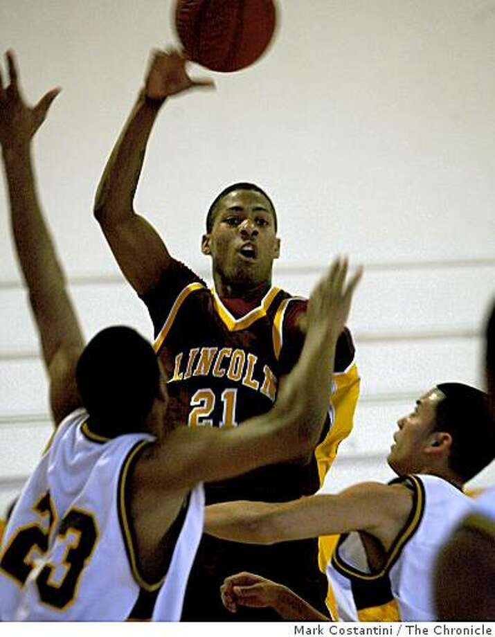 Lincoln High School's De'End Parker (21) passes the ball over, Mission High School defender Angelo Gulley (23) and an unidentified defender (right) at Mission High School in San Francisco, Calif. on Friday, February 13, 2009. Photo: Mark Costantini, The Chronicle