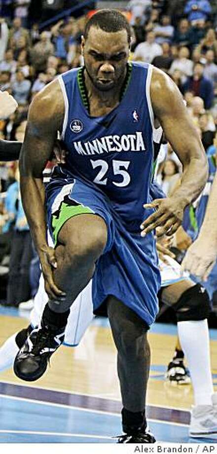 Minnesota Timberwolves center Al Jefferson holds his leg after injuring it in the second half of a game with the New Orleans Hornets in New Orleans. Photo: Alex Brandon, AP