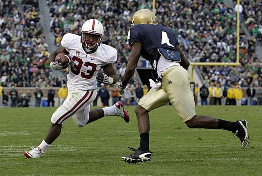 Stanford running back Stepfan Taylor, left, tries to get past Notre Dame cornerback Gary Gray during second half of an NCAA college football game in South Bend, Ind., Saturday, Sept. 25, 2010. Stanford defeated Notre Dame 37-14. Photo: Michael Conroy, AP