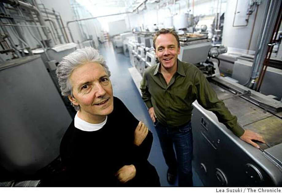 Tcho founders  Louis Rosetto (l to r) and Timothy Childs photographed at Tcho in San Francisco, Calif. on Wednesday, February 4, 2009. Behind them is the molding machine at Tcho, which was made in 1972 in East Germany, has been completely refurbished, is currently being  tested and will be up and running in April of 2009 and is photographed in San Francisco, Calif. on Wednesday, February 4, 2009. Photo: Lea Suzuki, The Chronicle