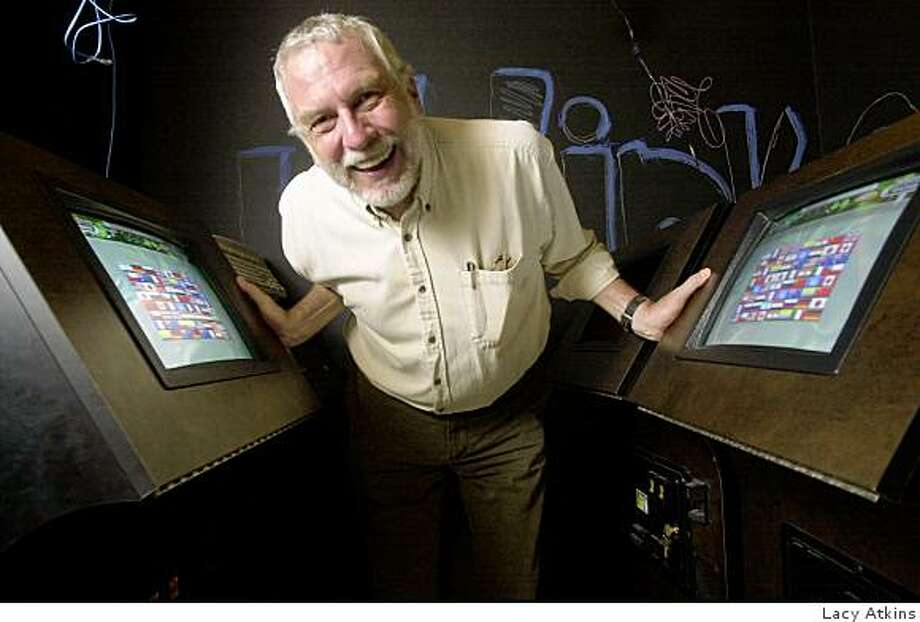 : BUSHNELL19b-C-16JUL01-BU-LA Nolan Bushnell, founder of atari and now uwinks, plays between two of his new games, at his office in Los Angeles, Monday July 16,01. Photo By Lacy Atkins/SanFrancisco Chronicle BUSHNELL19b-C-16JUL01-BU-LA Nolan Bushnell, founder of atari and now uwinks, plays between two of his new games, at his office in Los Angeles, Monday July 16,01. Photo By Lacy Atkins/SanFrancisco Chronicle Photo: Lacy Atkins