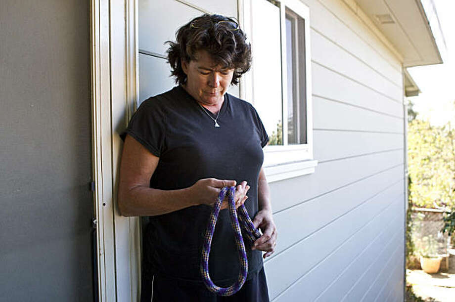 Mary Kate Hallock holds a leash that belonged to her dog Gloria at her home in Oakland, Calif., on Thursday, September 30, 2010.  Gloria, an 11-year-old Labrador Retriever, was shot and killed on Tuesday by Oakland police who were responding to a burglar alarm at the house. Photo: Laura Morton, Special To The Chronicle