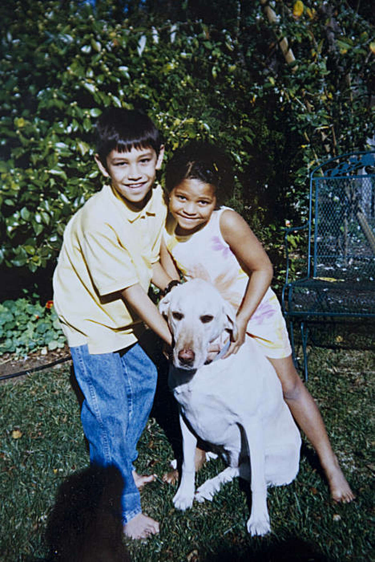 Matthew and Isabel Hallock are shown hugging their dog Gloria in a photo at their famiy home in Oakland, Calif., on Thursday, September 30, 2010. Gloria, an 11-year-old Labrador Retriever, was shot and killed on Tuesday by Oakland police who were responding to a burglar alarm at the house.