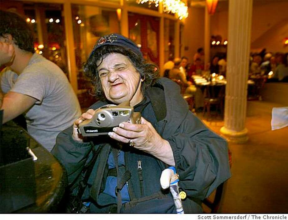 Millie, the Polarid Lady, has been a fixture in North Beach for many years. Here she sits at the bar at Enricos ready to make a polaroid photo for five dollars on March 2, 2002. Photo: Scott Sommersdorf, The Chronicle