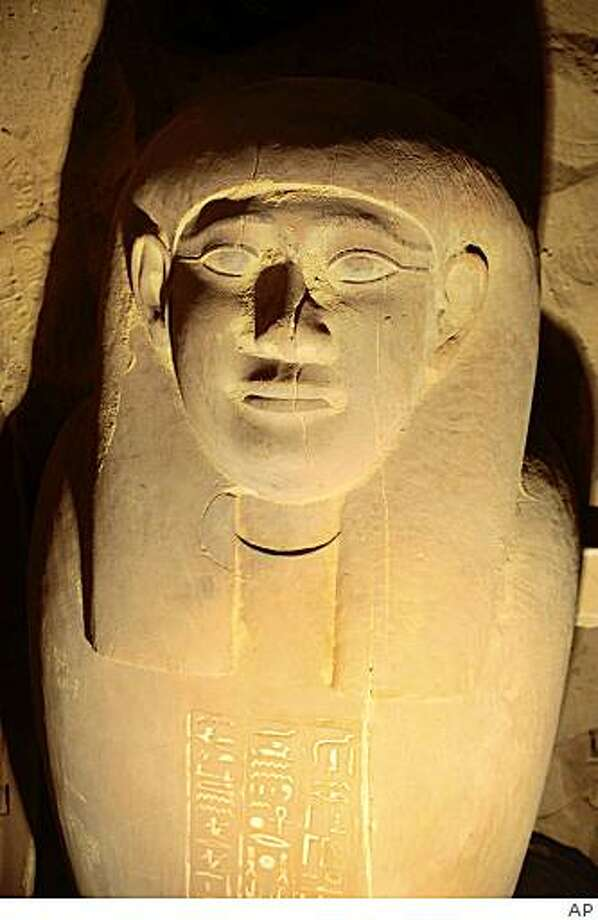 In this photo released Monday, Feb. 9, 2009 by Egypt's Supreme Council of Antiquities, a newly-discovered Egyptian mummy in a sarcophagus is seen in a tomb at Saqqara, south of Cairo, in Egypt, Sunday, Feb. 8, 2009. Egyptian archaeologists say they have discovered 30 mummies inside a 2,600-year-old tomb, discovered at an even more ancient site dating back to the 4,300-year-old 6th Dynasty, in the latest round of excavations at the vast necropolis of Saqqara south of Cairo. (AP Photo/Supreme Council of Antiquities) ** EDITORIAL USE ONLY, NO SALES ** Photo: AP