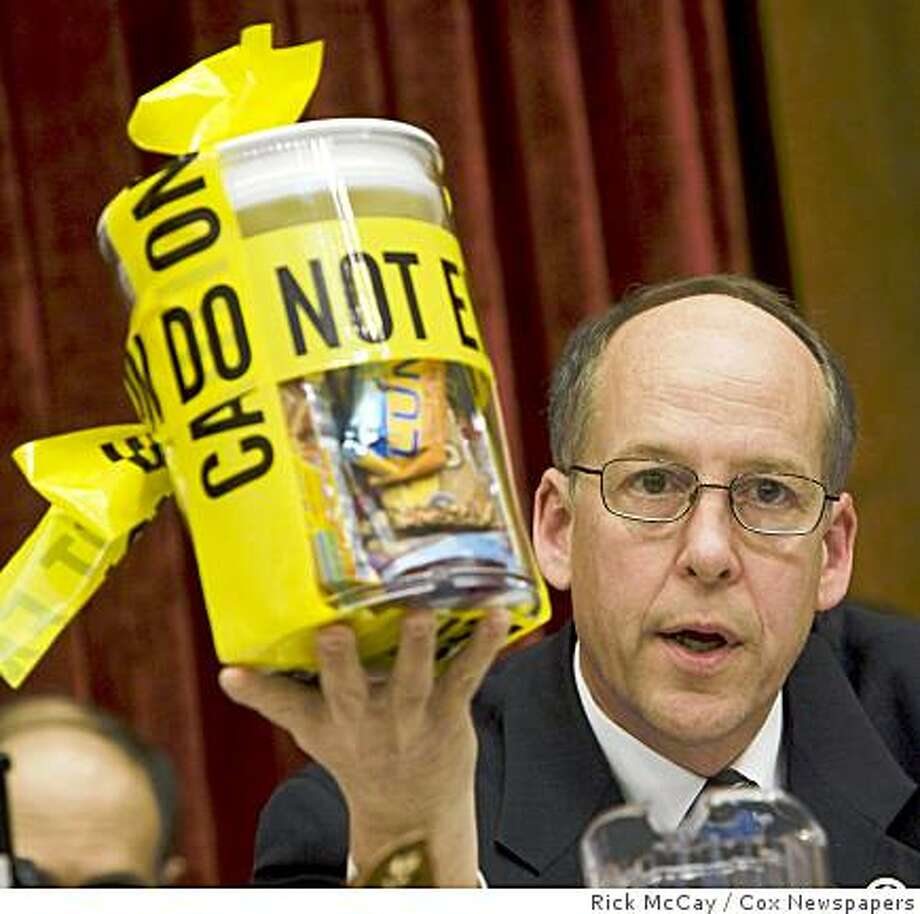 Photo by RICK MCKAY/Washington Bureau slug:  SALMONELLA-PEANUTS12 WASHINGTON...  Rep. Greg Walden (R-OR) holds a jar of peanut products and asks Stewart Parnell, owner and president of the Peanut Corporation of America, if he would be willing to unseal the jar and eat any of them. Parnell, subpoenaed to appear before the committee looking into the salmonella outbreak associated with peanut butter manufactured by his company,  asserted his Fifth Amendment rights and refused to answer any of the committee�s questions.  (Photo by RICK MCKAY/Cox Washington Bureau)  NO MAGS, NO SALES,  ONE TIME USE ONLY, RECEIVER USE ONLY,  EDITORIAL USE ONLY. Photo: Rick McCay, Cox Newspapers
