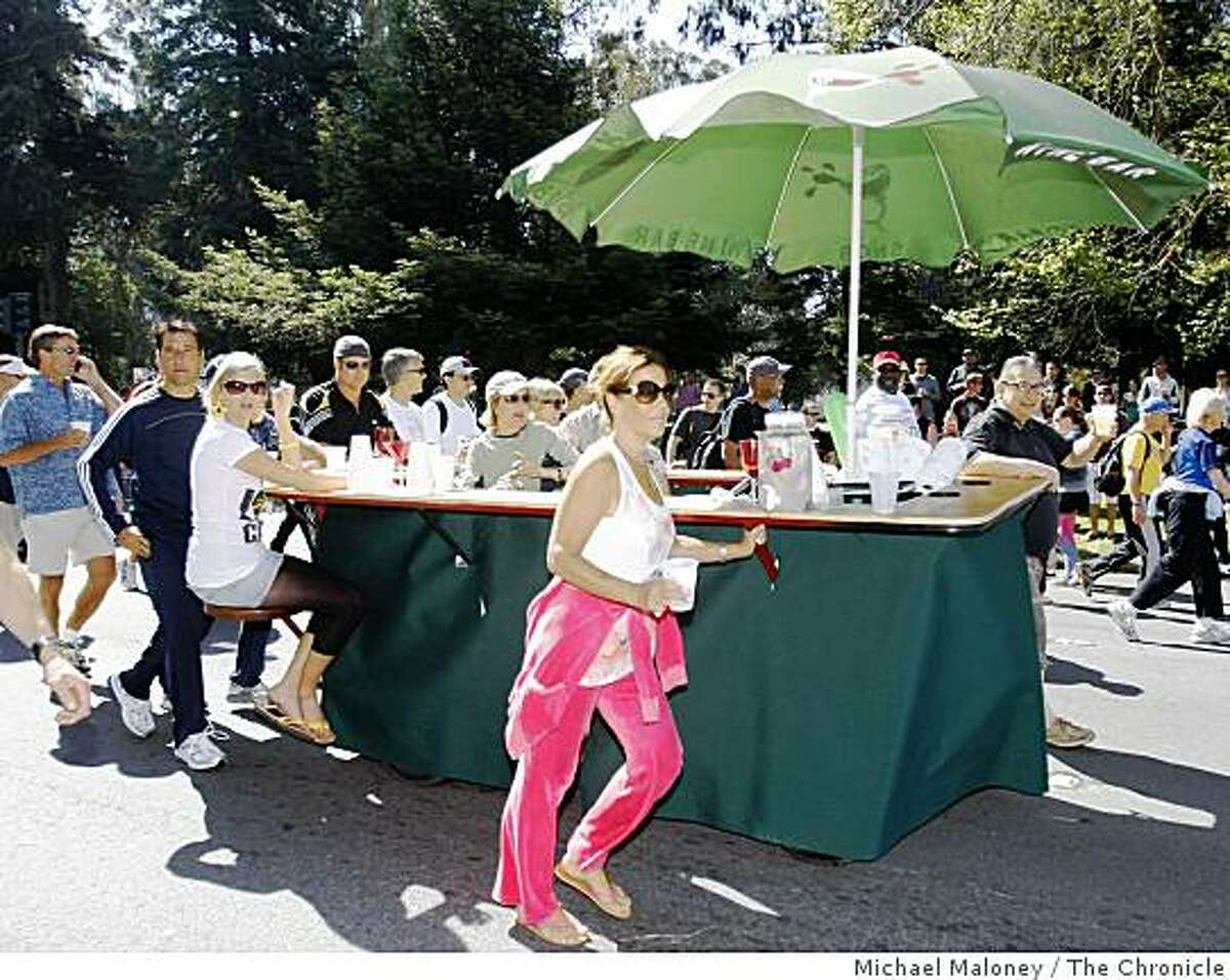 A traveling wine bar with customers rolls down Fell Street near Golden Gate Park during the 97th annual ING Bay to Breakers 12k foot race in San Francisco, Calif., on May 18, 2008.