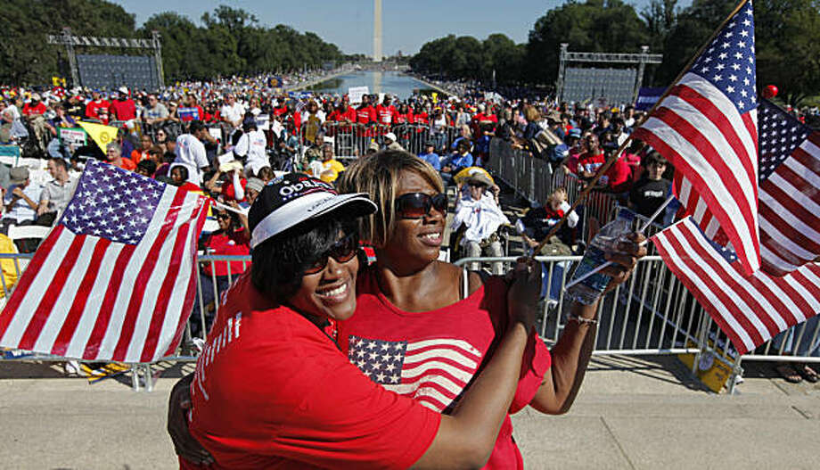 """Jackie Livingston, right, and Pat Williams, left, sisters from Trenton, N.J., join other activists at the Lincoln Memorial in the nation's capital to participate in the """"One Nation Working Together"""" rally to promote job creation, diversity and tolerance,Saturday, Oct. 2, 2010, in Washington. Photo: J. Scott Applewhite, AP"""