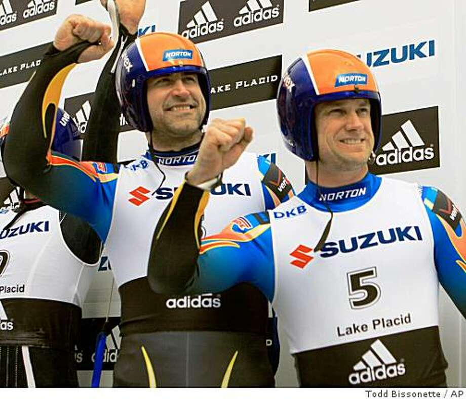 USA's Mark Grimmette, left, and Brian Martin react on the podium after finishing in third place in the men's doubles Luge World Championships in Lake Placid, N.Y., Friday, Feb 6, 2009. (AP Photo/Todd Bissonette) Photo: Todd Bissonette, AP