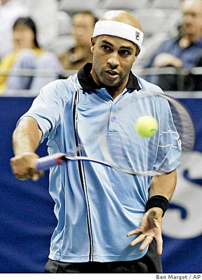 James Blake returns the ball to Sam Querrey during the quarterfinals of the SAP open tennis tournament Friday, Feb. 13, 2009, in San Jose. Photo: Ben Margot, AP