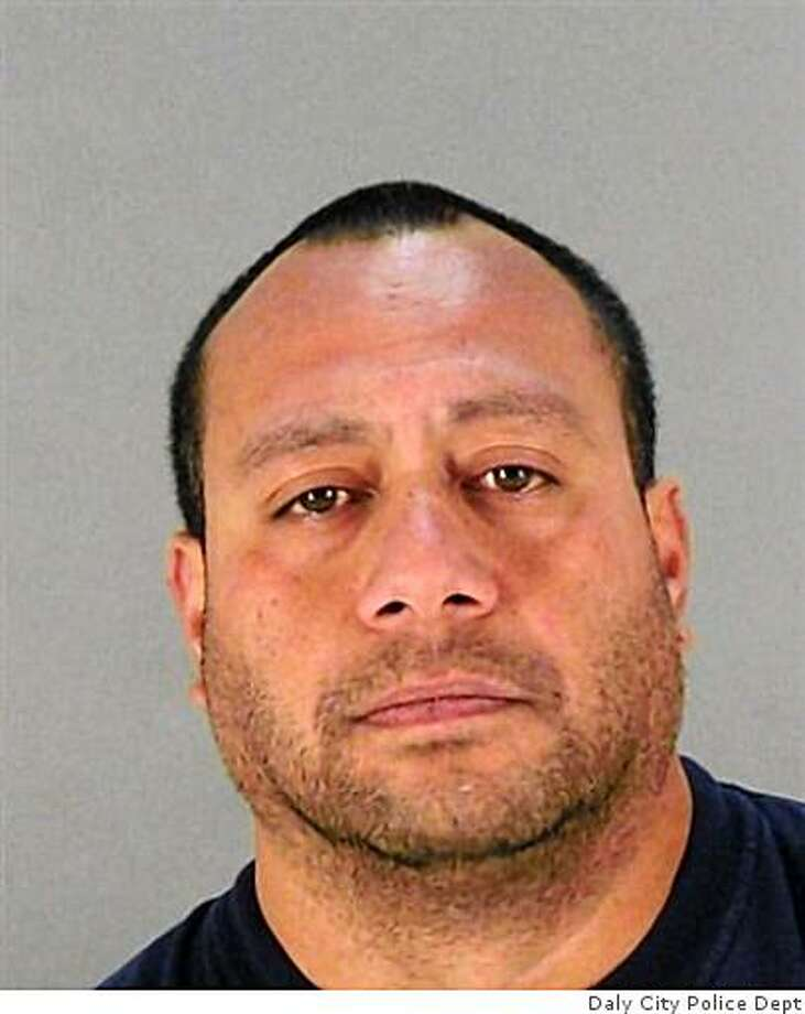 Sione Motuapuaka, accused of a string of armed robberies on the Peninsula and the sexual assault of a gas station clerk in San Bruno. Photo: Daly City Police Dept