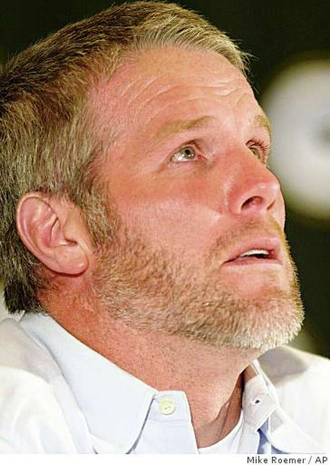 "** FILE ** This is a March 6, 2008 file photo showing Green Bay Packers quarterback Brett Favre getting choked up as he talks about his retirement during a news conference at Lambeau Field in Green Bay, Wisc.  Brett Favre's agent says the New York Jets quarterback will retire. The 39-year-old Favre instructed agent James ""Bus"" Cook to tell the team Wednesday Feb. 11, 2009 that he won't return for a 19th NFL season _ and second with the Jets. (AP Photo/Mike Roemer, File) Photo: Mike Roemer, AP"