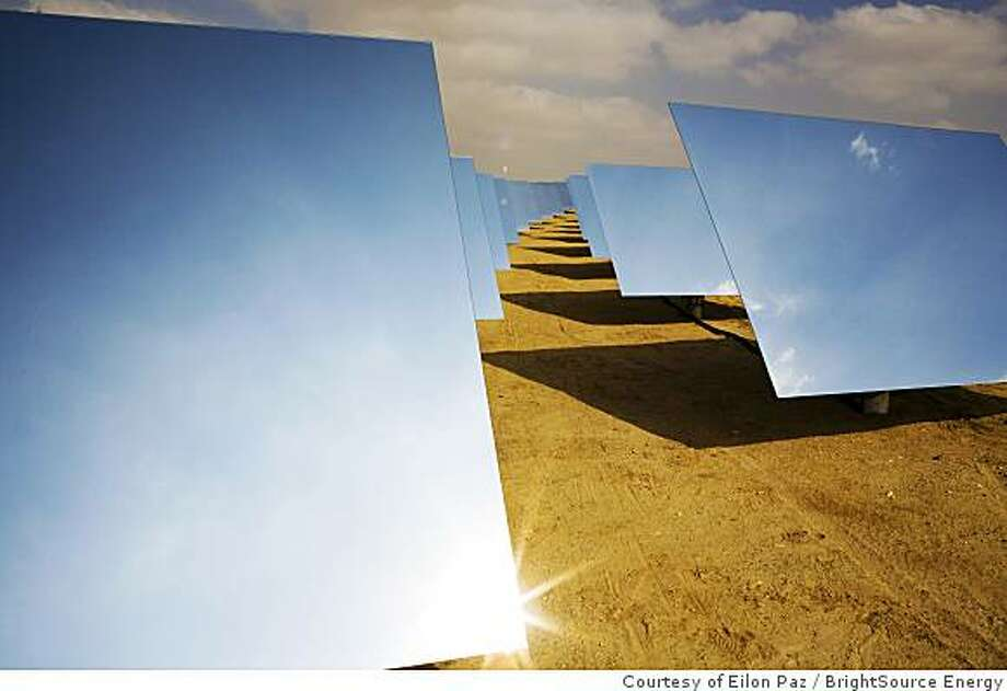 Sunlight bounces off mirrors at BrightSource Energy's solar plant in Israel's Negev Desert on Nov. 12, 2008. The California-based company hopes to benefit from green technology provisions in Congress' stimulus package. Photo: Courtesy Of Eilon Paz, BrightSource Energy