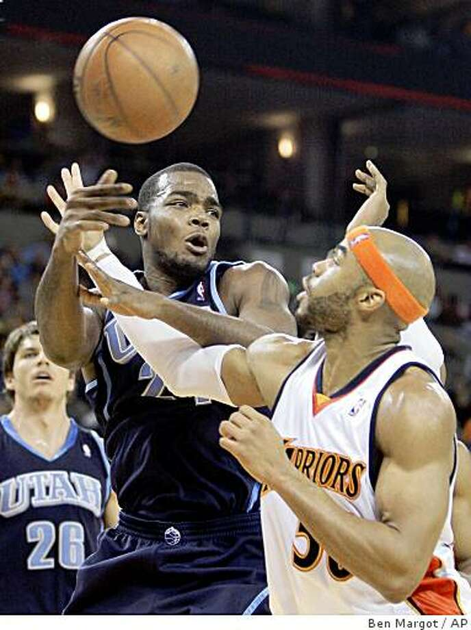 Utah Jazz's Paul Millsap, left, passes the ball away from Golden State Warriors' Corey Maggette during the first half of an NBA basketball game Sunday, Feb. 8, 2009, in Oakland, Calif. (AP Photo/Ben Margot) Photo: Ben Margot, AP