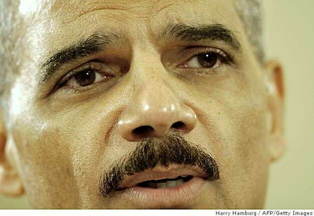 (FILES): This January 15, 2009 file photo shows Eric Holder testifying during his confirmation hearing before the Senate Judiciary Committee on Capitol Hill in Washington DC. The US Senate on February 2, 2009 confirmed US President Barack Obama's choice for attorney general, Eric Holder, making him the first African-American to hold the post of the US government's top lawyer.  Lawmakers voted 75-21 to confirm Holder after a confirmation process that moved in fits and starts because of Republican concerns over his position on volatile issues, including gun rights.     AFP PHOTO / Files / HARRY HAMBURG (Photo credit should read HARRY HAMBURG/AFP/Getty Images) Photo: Harry Hamburg, AFP/Getty Images
