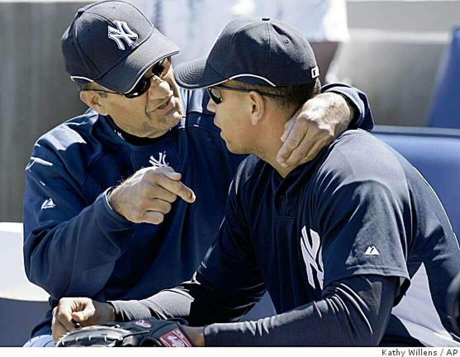 In this March 18, 2007, file photo, then-New York Yankees manager Joe Torre has a chat with third baseman Alex Rodriguez before a spring training baseball game against the Philadelphia Phillies in Tampa, Fla. Yankees general manager Brian Cashman thinks the Yankees should rally around Rodriguez following a book in which Torre portrayed A-Rod a divisive figure in the New York clubhouse. Photo: Kathy Willens, AP