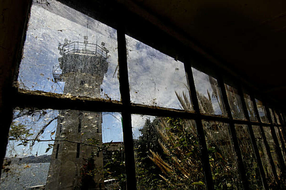 One of the guard towers, on the perimeter of the State prison, is seen through a row of very dirty windows nearby. Officials from San Quentin State Prison held a tour of the newly completed Lethal Injection Facility, on Tuesday Sept. 21, 2010 in San Quentin, Calif.