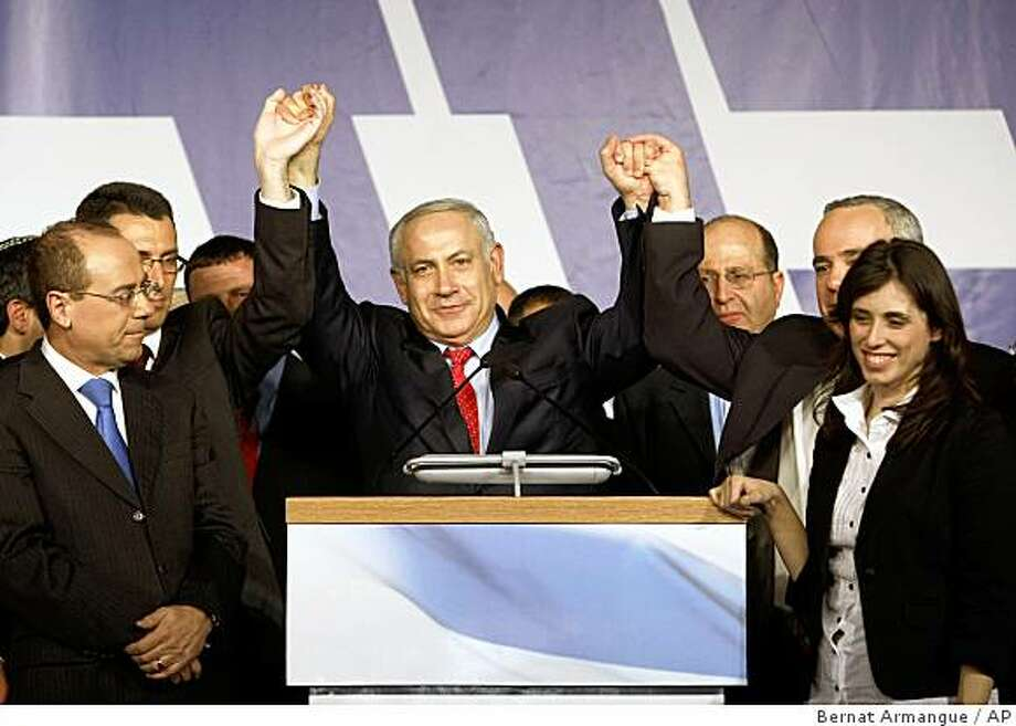 Likud Party leader Benjamin Netanyahu, centre and party officials greet supporters at the Likud election headquarters at the convention center in Tel Aviv, Wednesday, Feb. 11, 2009. (AP Photo/Bernat Armangue) Photo: Bernat Armangue, AP