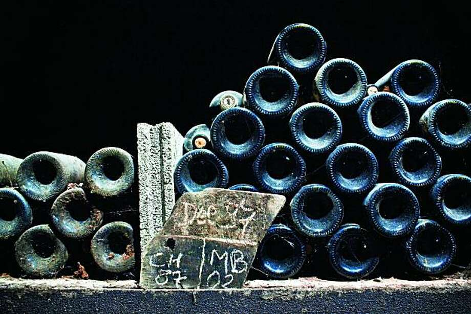 Bottles in a Burgundian wine cellar. Photo: Courtesy Ten Speed Press