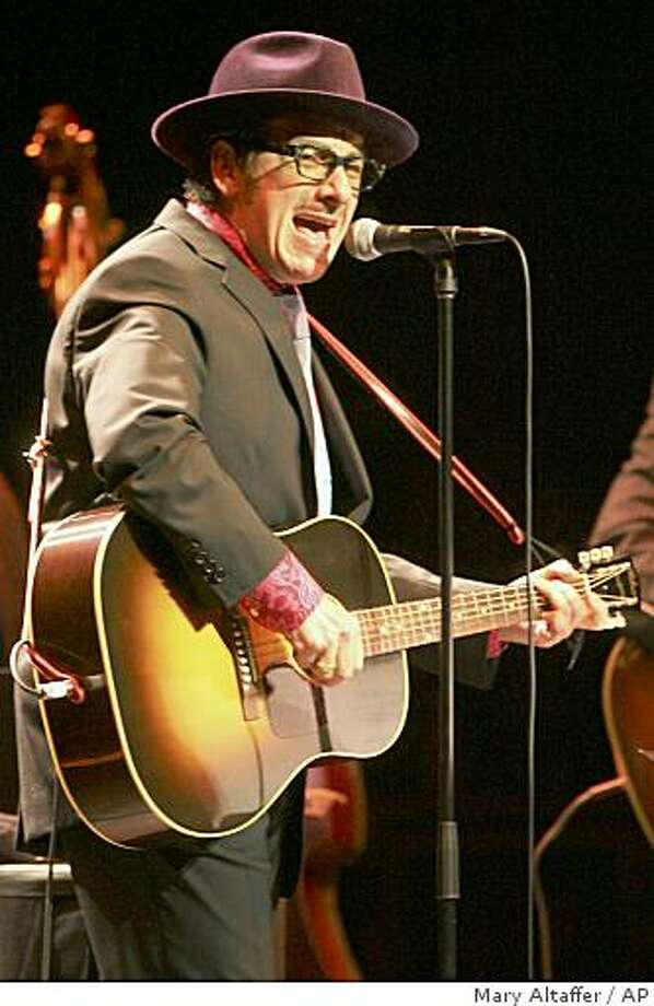 British singer-songwriter Elvis Costello performs with The Sugarcanes Wednesday, June 10, 2009 at the Beacon Theater in New York. Photo: Mary Altaffer, AP