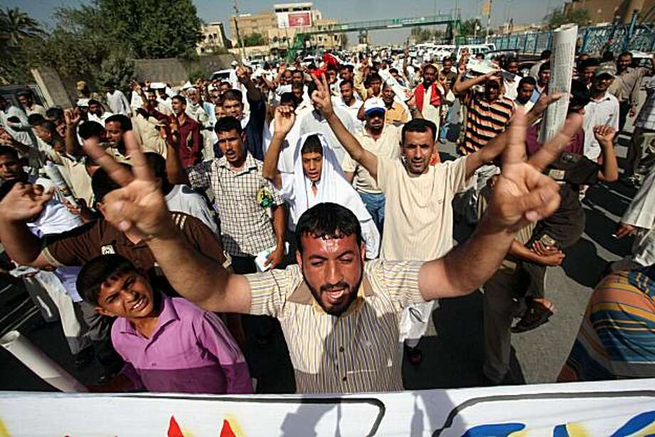 Supporters of Shiite cleric Muqtada al-Sadr hold a demonstration following Friday prayers in Kufa, 160 kilometers (100 miles) south of Baghdad, Iraq, Friday, Oct. 1, 2010. Powerful Shiite cleric Muqtada al-Sadr has agreed to support the bid by Iraq's prime minister to retain power, aides said Friday, in a move that could speed an end to the seven-month political impasse and bring dealmaking that may give key concessions to al-Sadr's anti-American bloc. The decision by al-Sadr would mark a significant boost for Prime Minister Nouri al-Maliki's Shiite-led coalition to secure enough parliament seats to form a new government. Photo: Alaa Al-Marjani, AP