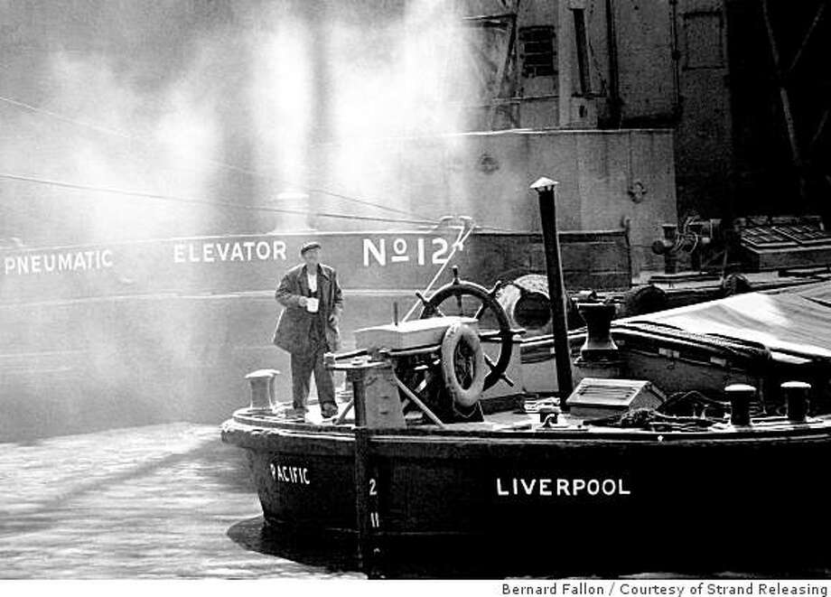 "Grain Barge Docks in 1969 for the movie ""Of Time and the City."" Photo: Bernard Fallon, Courtesy Of Strand Releasing"