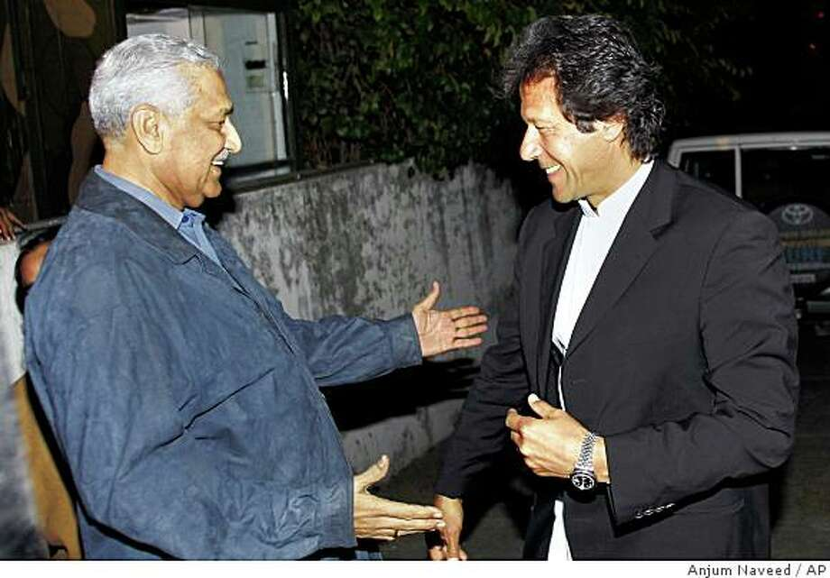 Disgraced Pakistani nuclear scientist Abdul Qadeer Khan, left, speaks with  opposition leader Imran Khan after their meeting  in Islamabad, Pakistan on Saturday, Feb. 7, 2009. Pakistan defended Saturday the easing of restrictions on Khan, saying the man who once confessed to passing nuclear secrets to Iran, North Korea and Libya no longer posed a risk because his smuggling network had been dismantled. (AP Photo/Anjum Naveed) Photo: Anjum Naveed, AP