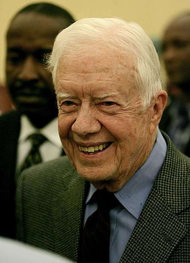 (FILES) File photograph dated April 17, 2010 shows former US president Jimmy Carter, who has been monitoring the Sudanese elections, smiling after his press conference in Khartoum. Carter, 85, was hospitalized September 28, 2010 in Cleveland, Ohio, afterfalling ill on a flight to the city, an airport spokeswoman told AFP. The former president, who maintains a busy public schedule and recently released his 26th book, was taken to the hospital around 11:30 am (1530 GMT) by paramedics who met his plane uponarrival. Mayo did not have any information about Carter's condition but said he was taken to Metro Health Hospital. A spokeswoman for the hospital said she was unable to confirm anything at this time. Photo: Ashraf Shazly, AFP/Getty Images