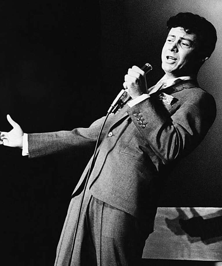 **CORRECTS FISHER'S AGE AT DEATH TO 82** FILE - Making his comeback as a singer, Eddie Fisher performs at the Desert Inn, in this Jan. 27, 1964 file photo taken in Las Vegas, Nev. Fisher, whose huge fame as a pop singer was overshadowed by scandals endinghis marriages to Debbie Reynolds and Elizabeth Taylor, died Wednesday night Sept. 22, 2010 of complications from hip surgery at a hospital in Berkeley. He was 82. Photo: AP