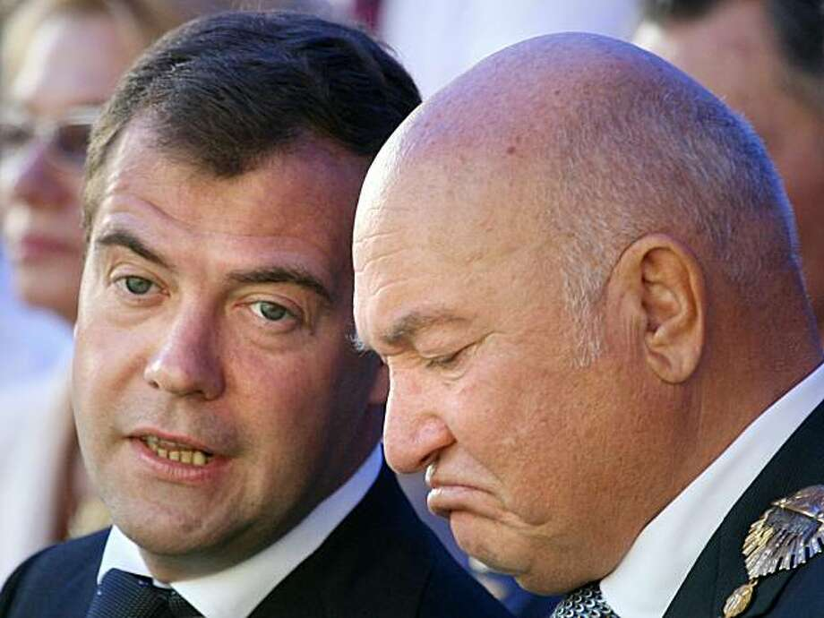 """(FILES) A file picture taken on September 7, 2008 shows Russian President Dmitry Medvedev (L) speaking with Moscow Mayor Yuri Luzhkov during the celebration of City Day in Moscow. Medvedev on September 28, 2010 fired Luzhkov, ending a controversial 18 year rule that saw the Russian capital boom but also attracted bitter criticism. A decree, published on the Kremlin website, ordered Luzhkov, 74, to be """"dismissed from the position of Moscow mayor because he has lost the confidence of the Russian president."""" Photo: Alexey Sazonov, AFP/Getty Images"""