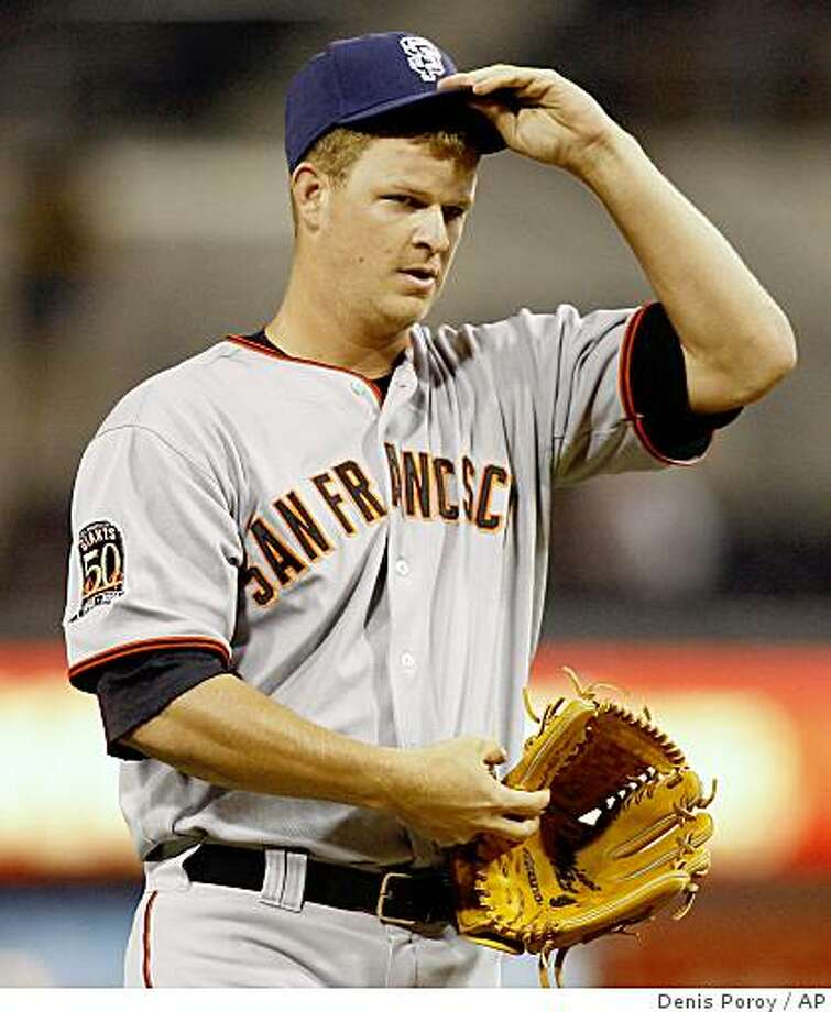 San Francisco Giants pitcher Matt Cain adjusts hit cap after giving up at three-run home run to San Diego Padres' Adrian Gonzalez during the first inning of a baseball game Thursday, Sept. 11, 2008, in San Diego. (AP Photo/Denis Poroy) Photo: Denis Poroy, AP