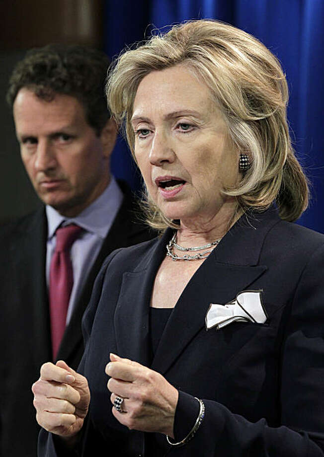 Secretary of State Hillary Rodham Clinton, accompanied by Treasury Secretary Timothy Geithner, talks about alleged human rights abuses in Iran, Wednesday, Sept. 29, 2010, at the State Department in Washington. Photo: J. Scott Applewhite, AP