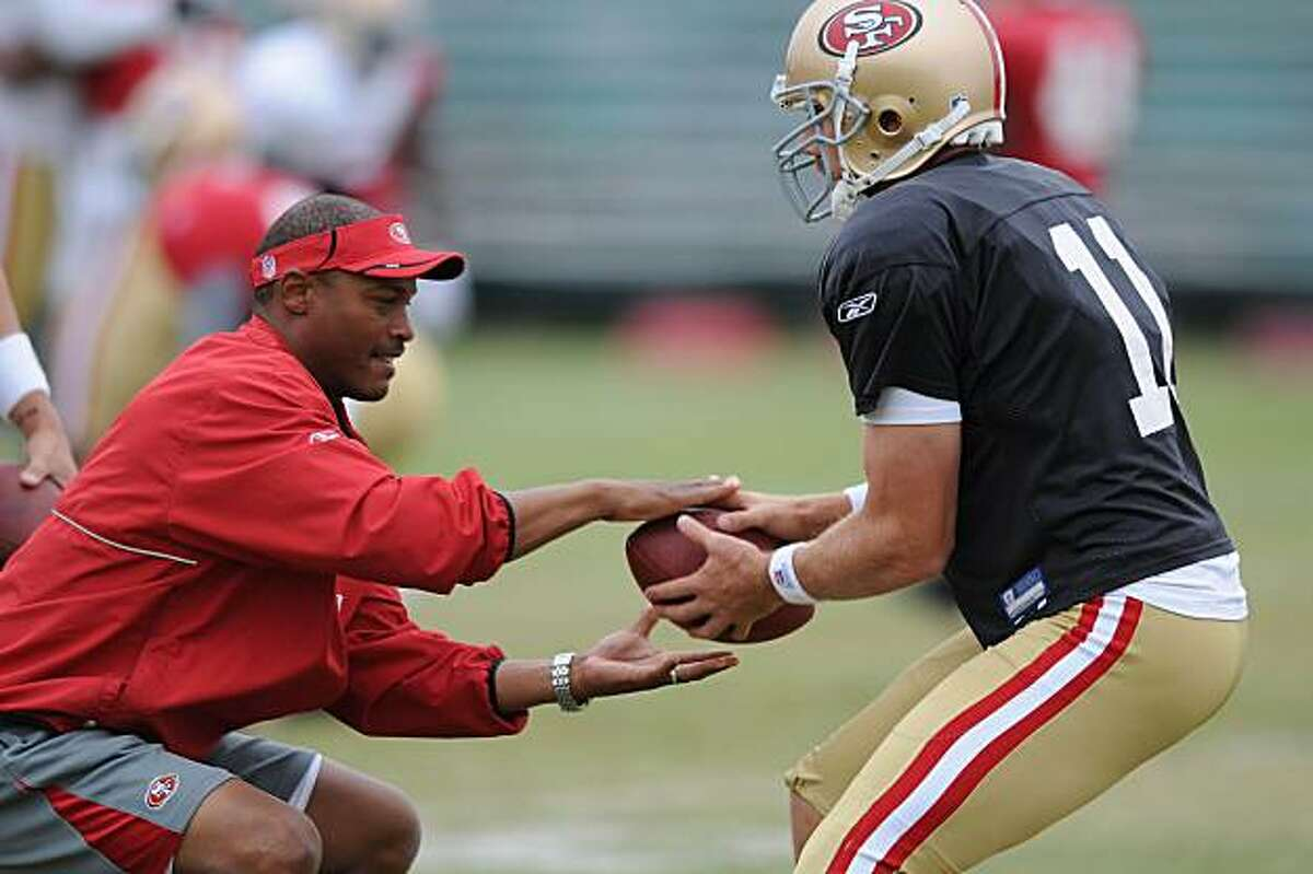 49ers quarterbacks coach Mike Johnson (l to r) works with quarterback Alex Smith during the San Francisco 49ers pre season practice at their Santa Clara, Calif., practice facility on Thursday, August 12, 2010.