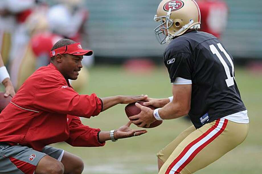 49ers quarterbacks coach Mike Johnson (l to r) works with quarterback Alex Smith during the San Francisco 49ers pre season practice at their Santa Clara, Calif., practice facility on Thursday, August 12, 2010. Photo: Chad Ziemendorf, The Chronicle