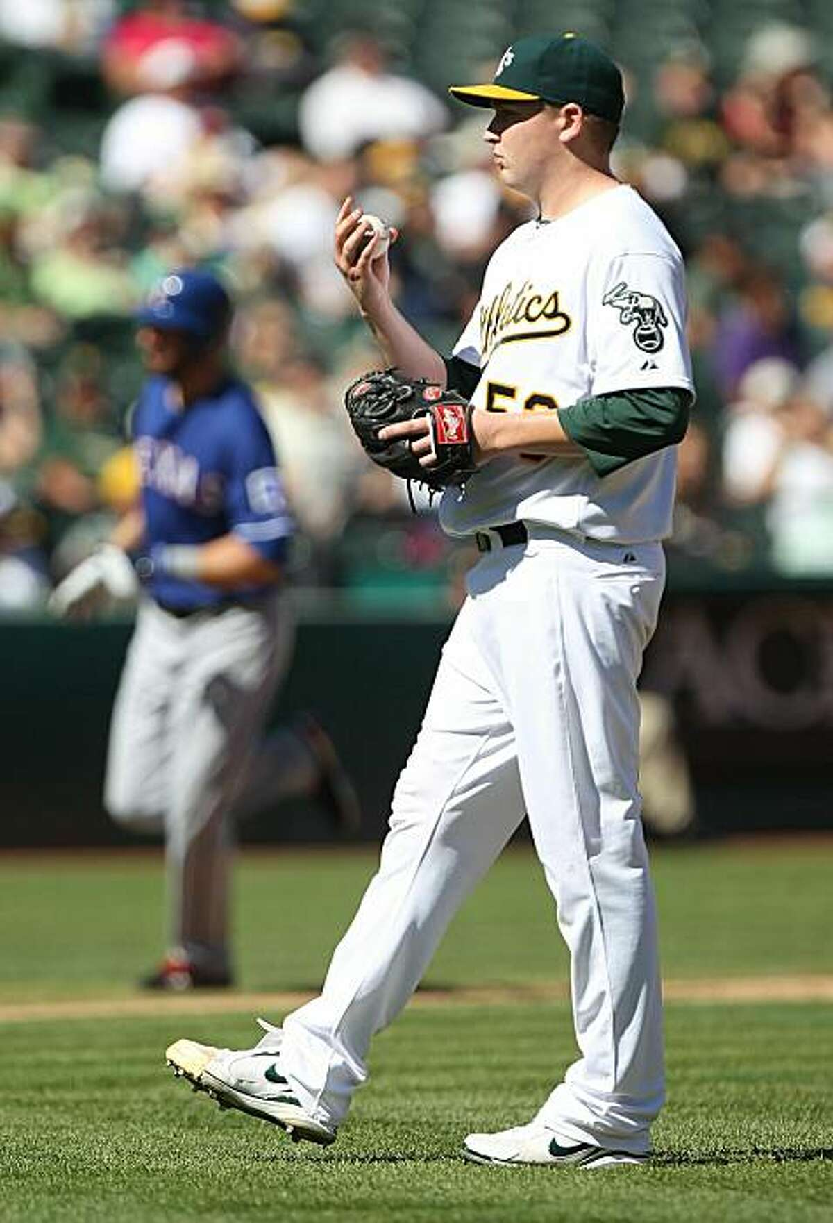 OAKLAND, CA - SEPTEMBER 26: Jeff Francoeur #21 of the Texas Rangers rounds the bases after hitting a home run off of Trevor Cahill #53 of the Oakland Athletics during a Major League Baseball game at the Oakland-Alameda County Coliseum on September 26, 2010 in Oakland, California.