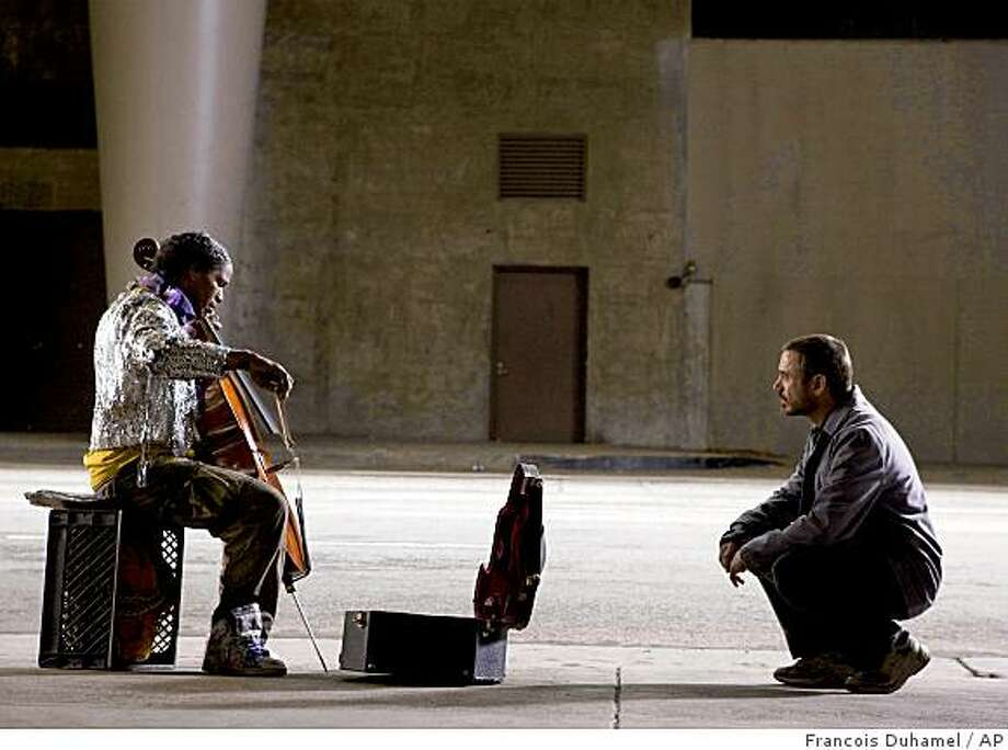 """In this image released by Paramount Pictures/DreamWorks, Jamie Foxx, portrays a schizophrenic Juilliard-trained cellist, left, and Robert Downey Jr. portrays a a Los Angeles Times columnist in a scene from """"The Soloist."""" Photo: Francois Duhamel, AP"""