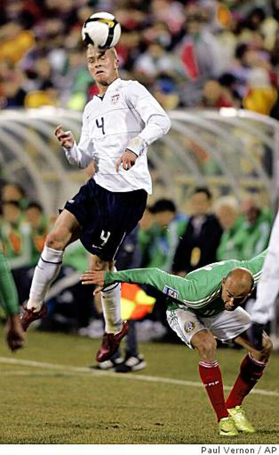 United States midfielder Michael Bradley (4) heads the ball over Mexico forward Carlos Ochoa (11) during the first half of a World Cup qualifying soccer match, Wednesday, Feb. 11, 2009, in Columbus, Ohio. Bradley scored twice leading the USA to a 2-0 win. Photo: Paul Vernon, AP
