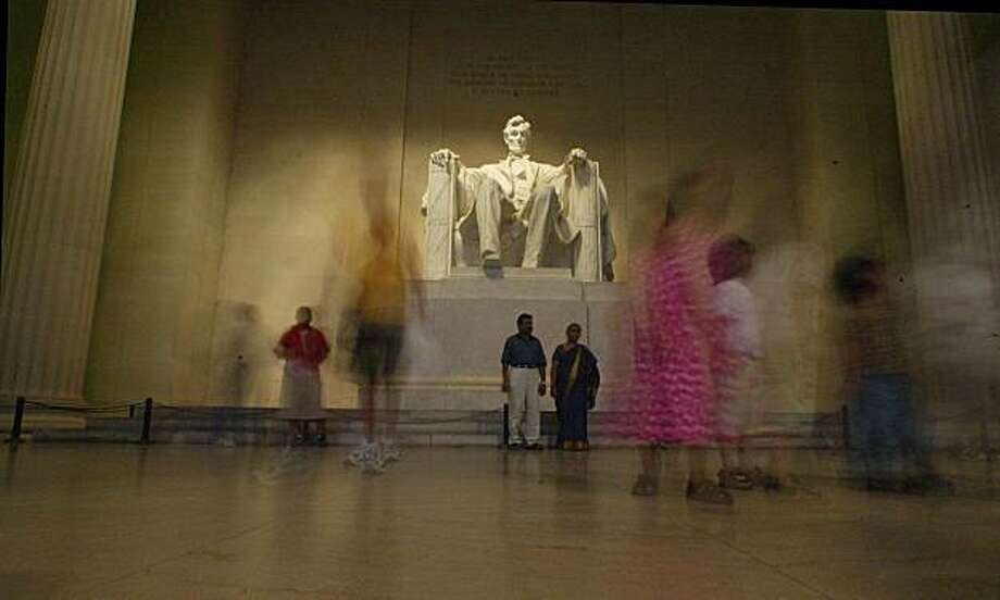 **ADVANCE FOR SUNDAY, FEB. 8** **FILE** In this June 30, 2002 file photo some of the visitors to the Lincoln Memorial are blurred in this time exposure at the memorial in Washington.    (AP Photo/Rick Bowmer, file) Photo: Rick Bowmer, AP