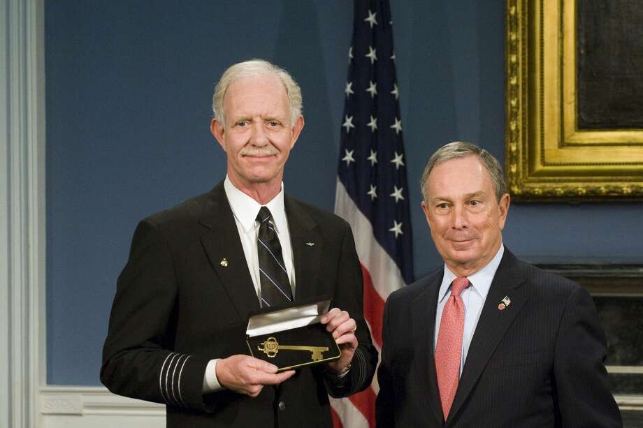 NEW YORK - FEBRUARY 9:  Pilot Chesley B. Sullenberger (L) of US Airways Flight 1549 holds up a key to city at City Hall, where Mayor Michael Bloomberg (R) presented him and his fellow crew members keys to the city, on February 9, 2008 in New York City.  Sullenberger executed an emergency landing on the Hudson River on January 15, saving all the passengers on board. (Photo by Michael Nagle/Getty Images) Photo: Michael Nagle, Getty Images